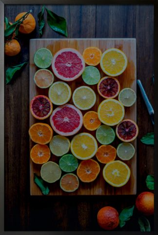 Variety of citrus on chopping board poster